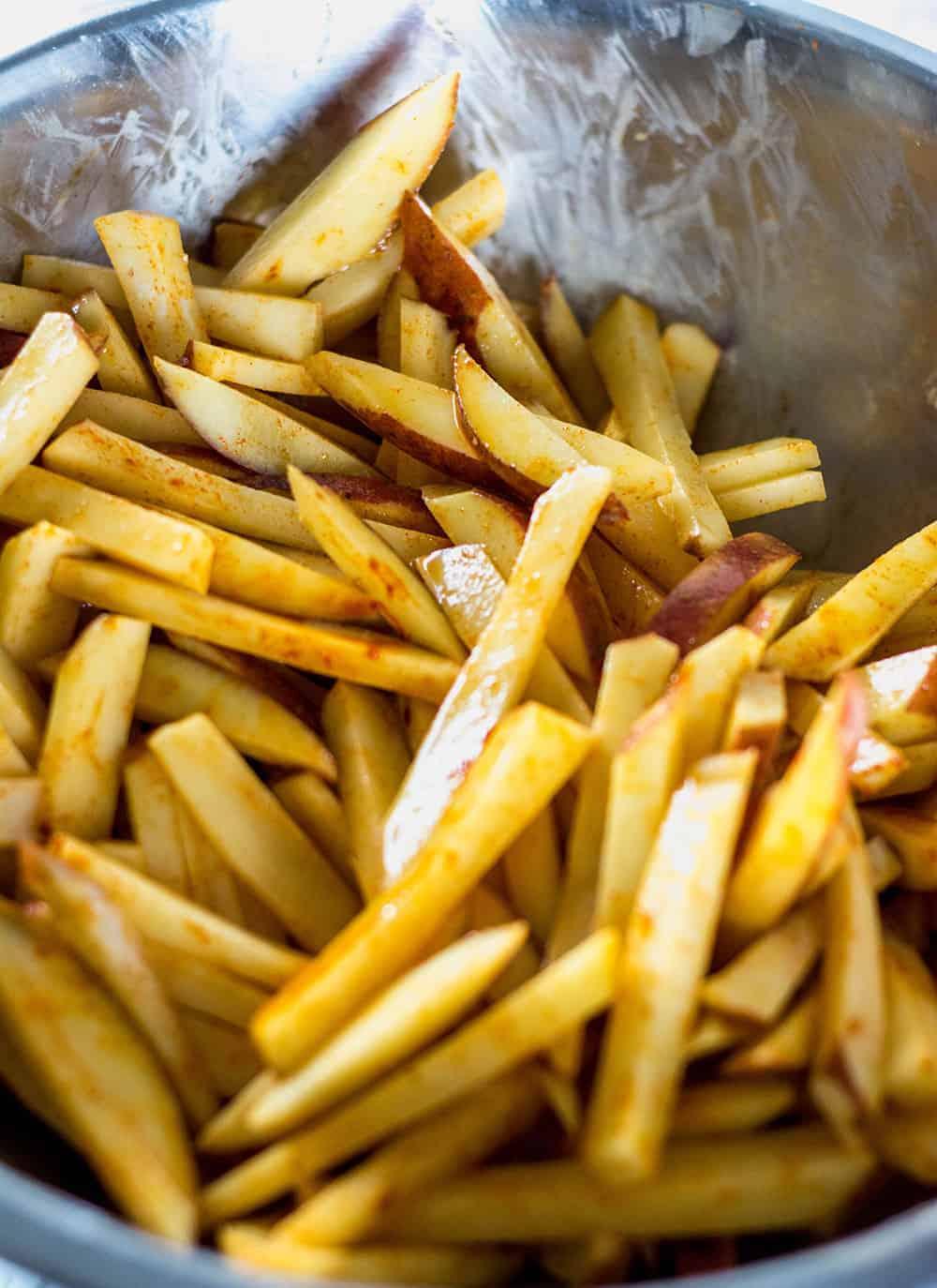 Vegan Pinto Bean Chili Cheese Fries, seasoned fries in a bowl