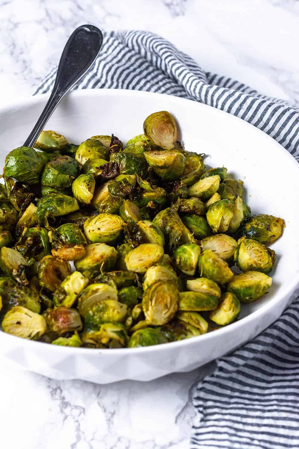 Easy Roasted Brussels Sprouts in a white bowl
