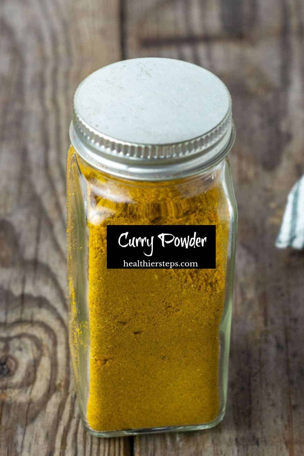 Easy curry powder in a glass bottle with a black label