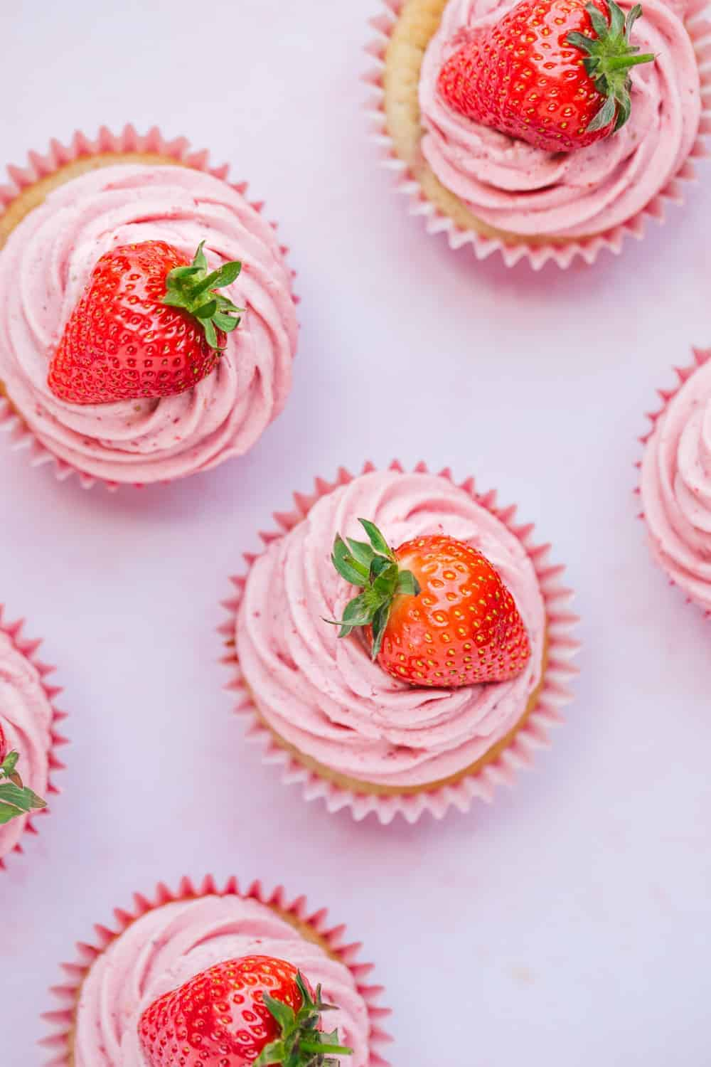 Overhead view of pink strawberry cupcakes