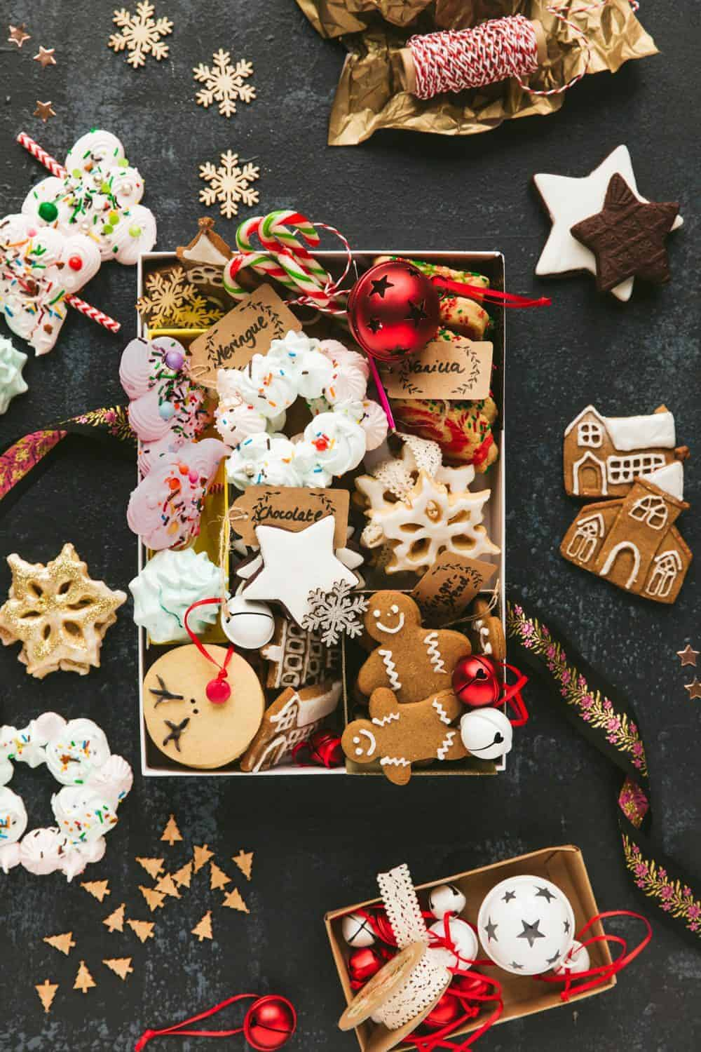 A christmas cookie gift box containing a variety of biscuits and cookies.