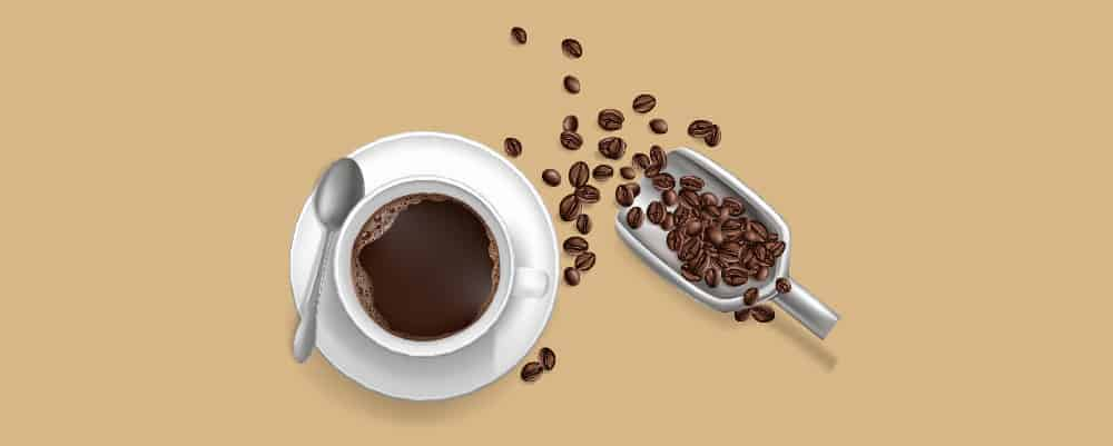 A cup of coffee with a scoop of coffee beans behind