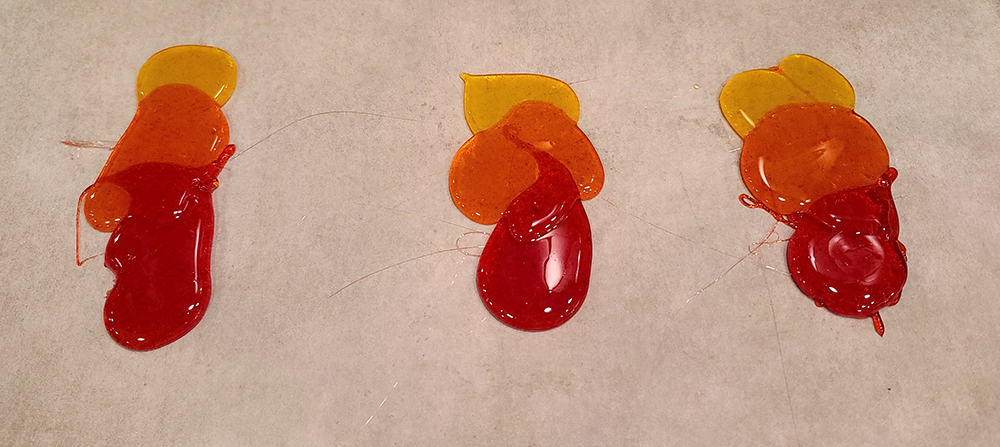 Isomalt circles in red, orange, and yellow