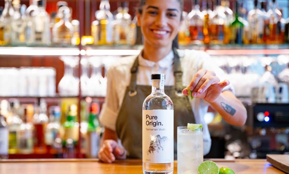 Waitress making cocktail with Pure Origin Vodka