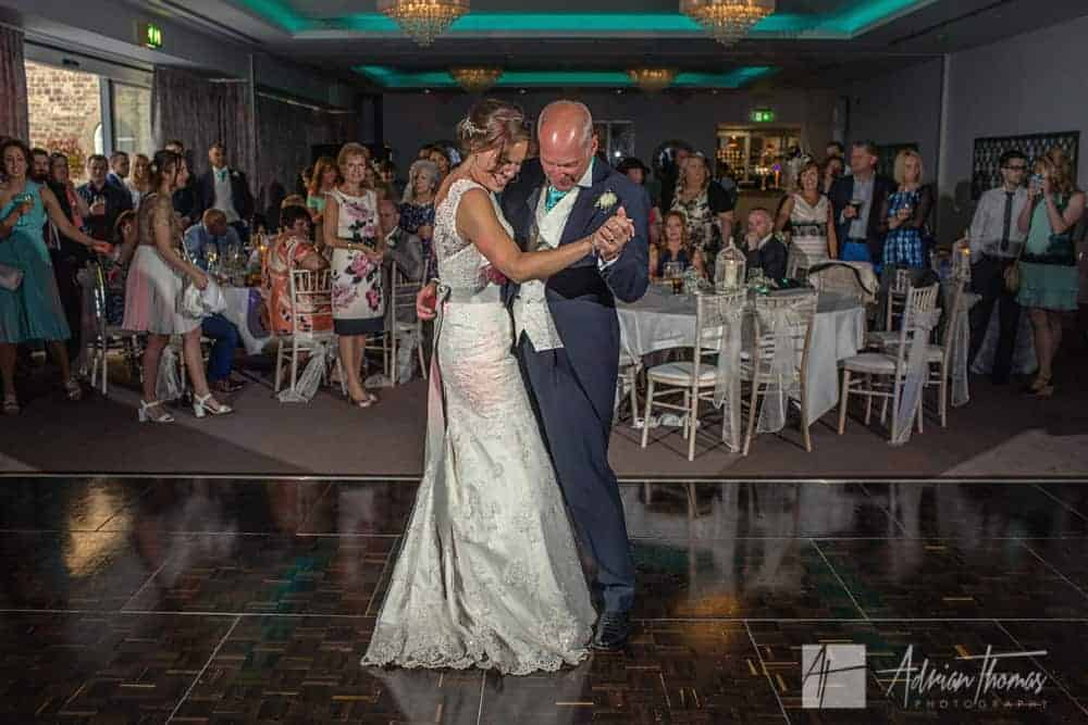 Bride and her dad dancing.