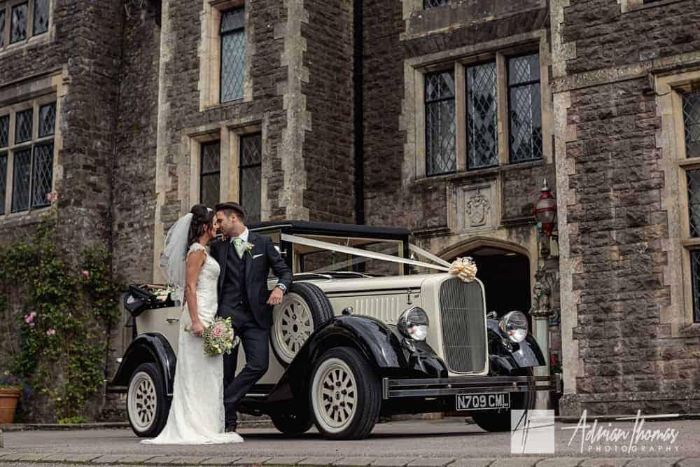 Bride and groom kissing at Miskin Manor Hotel wedding venue.