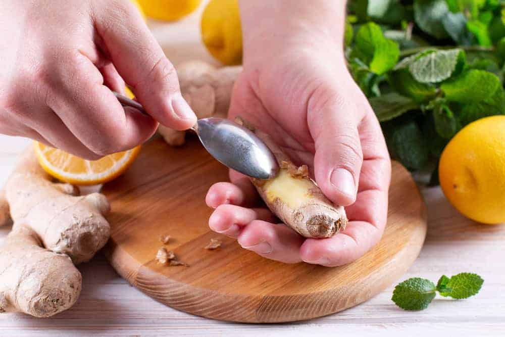 peeling ginger using a spoon