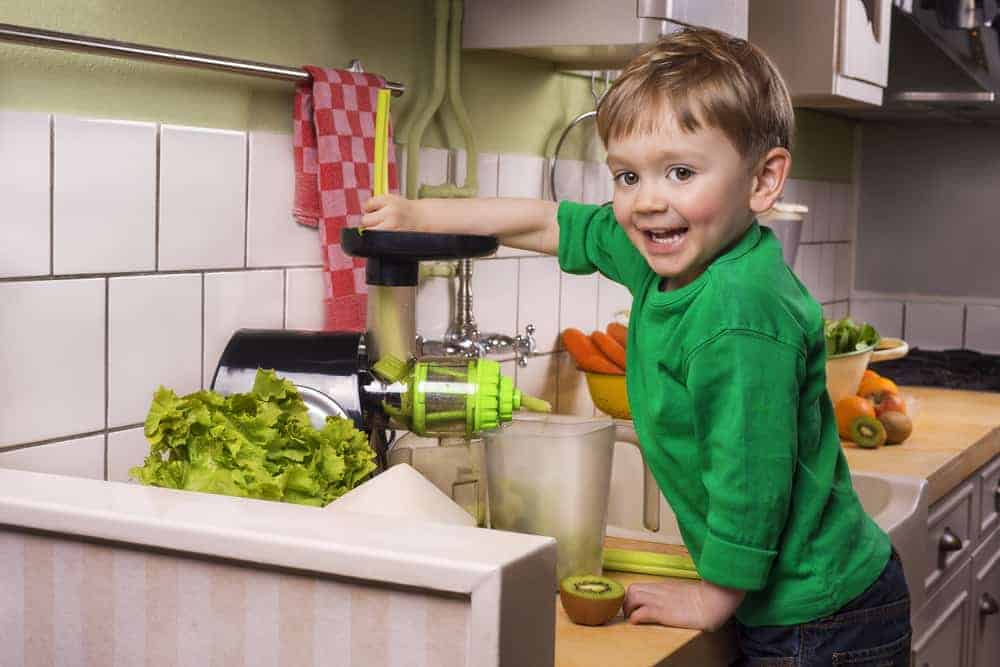 kid making green juice