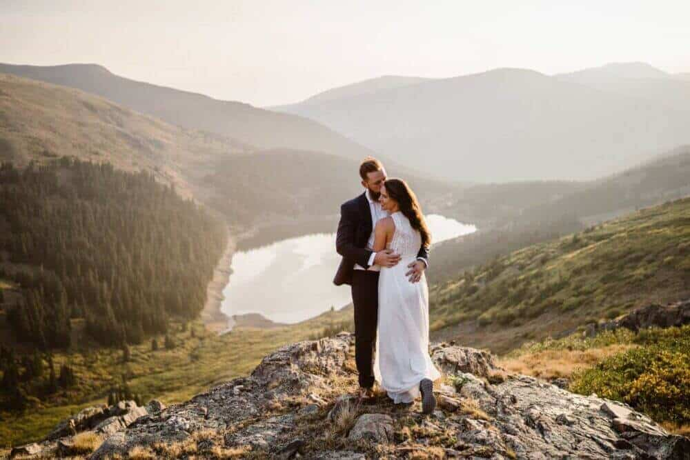Bride and Groom Hugging Best Places to Elope in Colorado