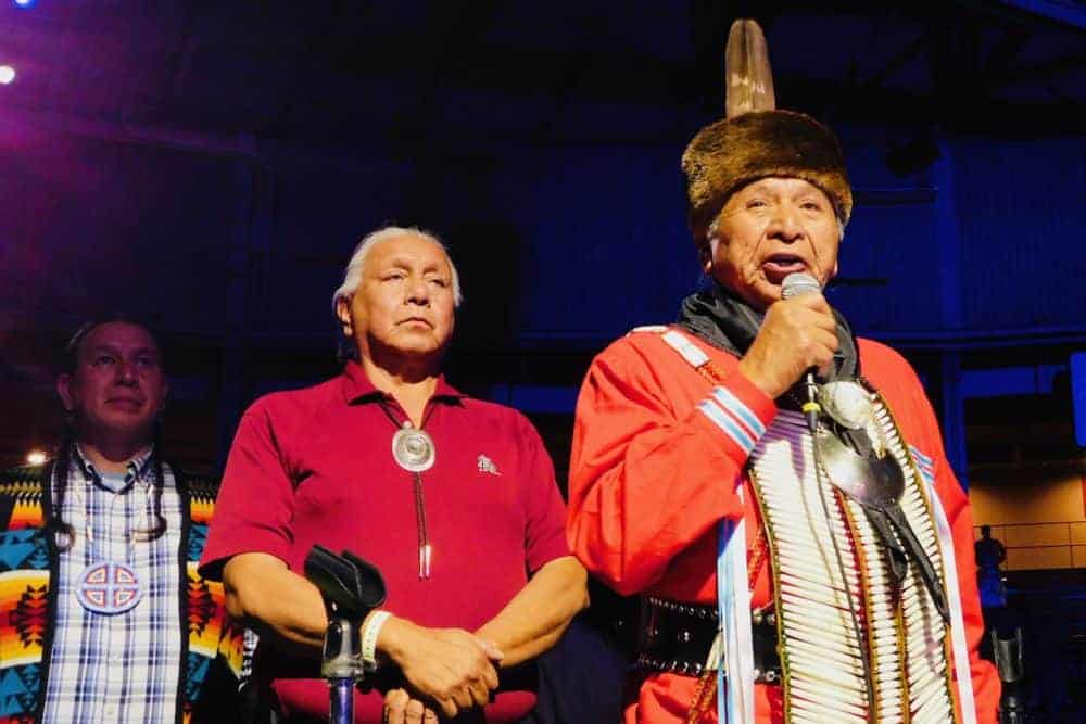 An elder opens the gathering of nations with a blessing