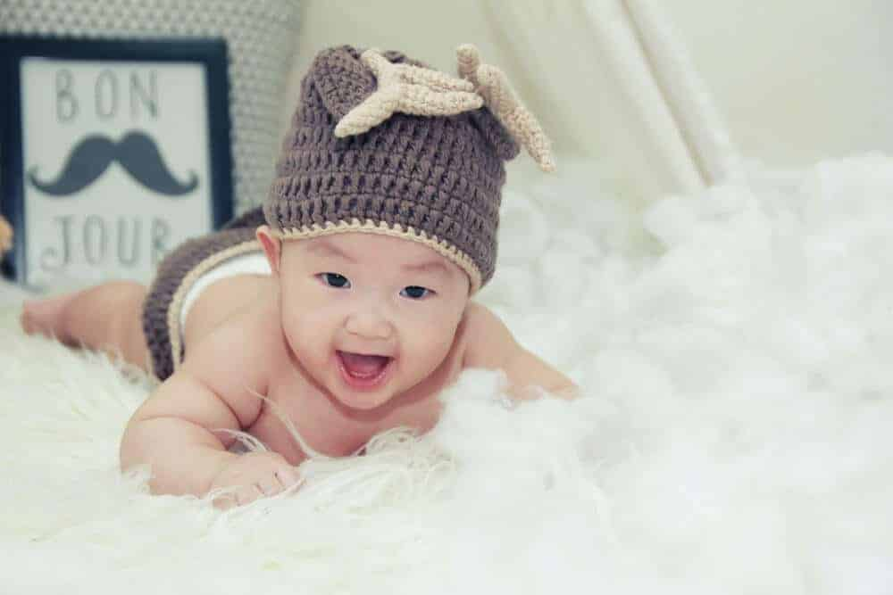 Newborn in funny outfit