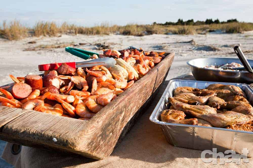Close look at the shrimp boil buffet on the beach. Wedding dinner cruise Charleston SC