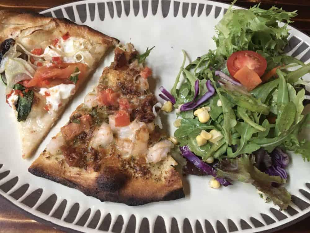 Fresh brick oven pizza and salad at the gulf coast zoo's safari club restaurant/