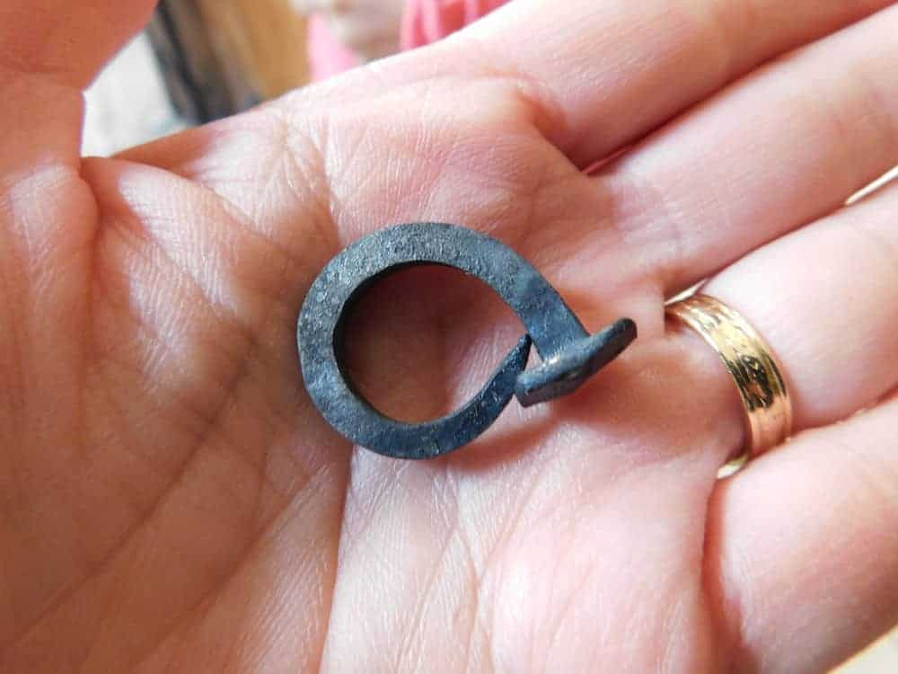 A nail hammered into a ring at the famers' museum blacksmith shop in upstate new york.