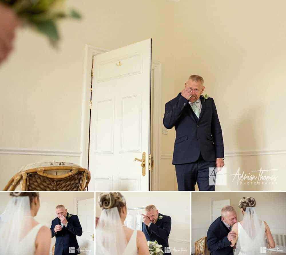 Emotional photograph of dad seeing his daughter in wedding dress.