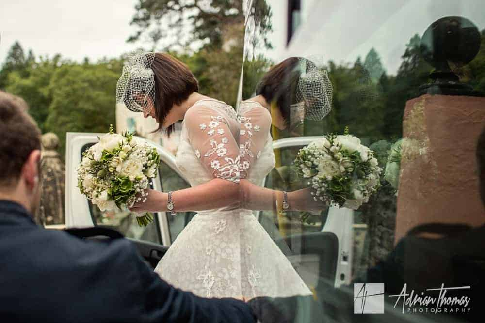 Bride arriving and stepping out of wedding car
