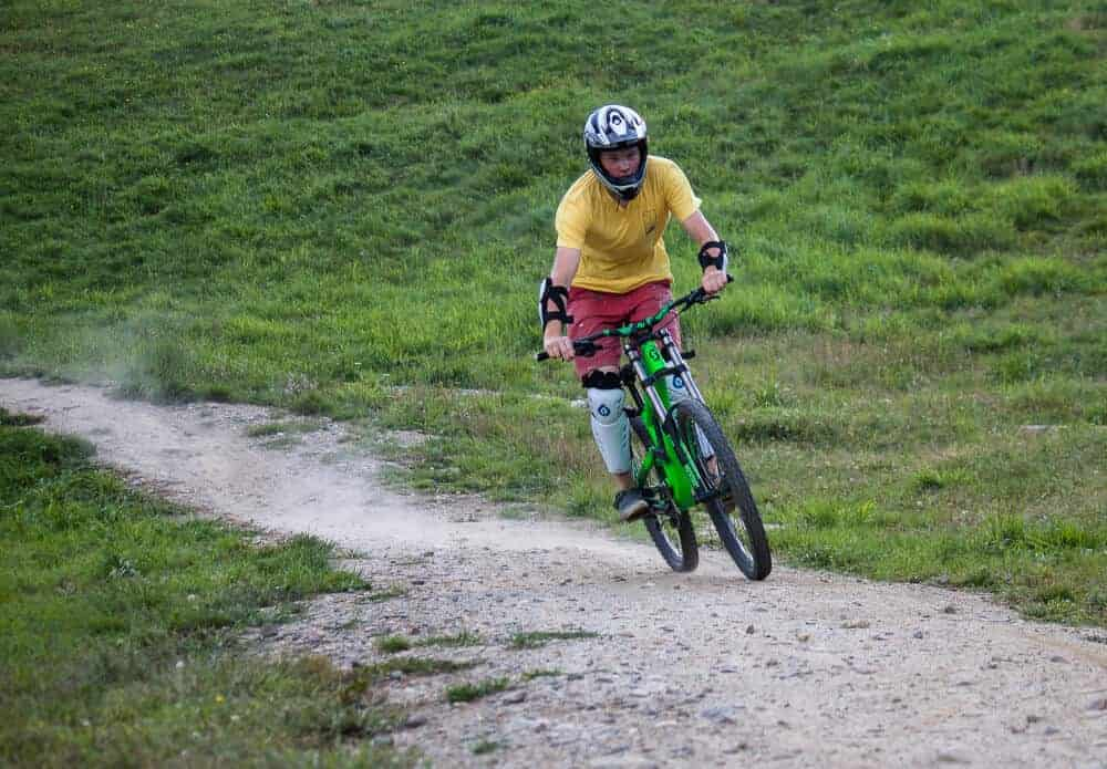 Rowan riding a fast down a Mount Snow mountain biking trail in Vermont.