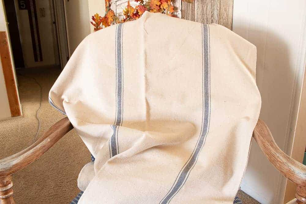grain sack fabric draped over antique chair