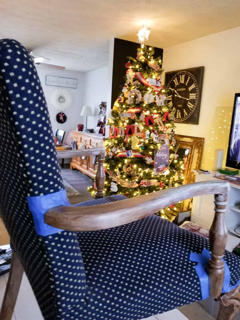 Blue fabric chair with wood trim