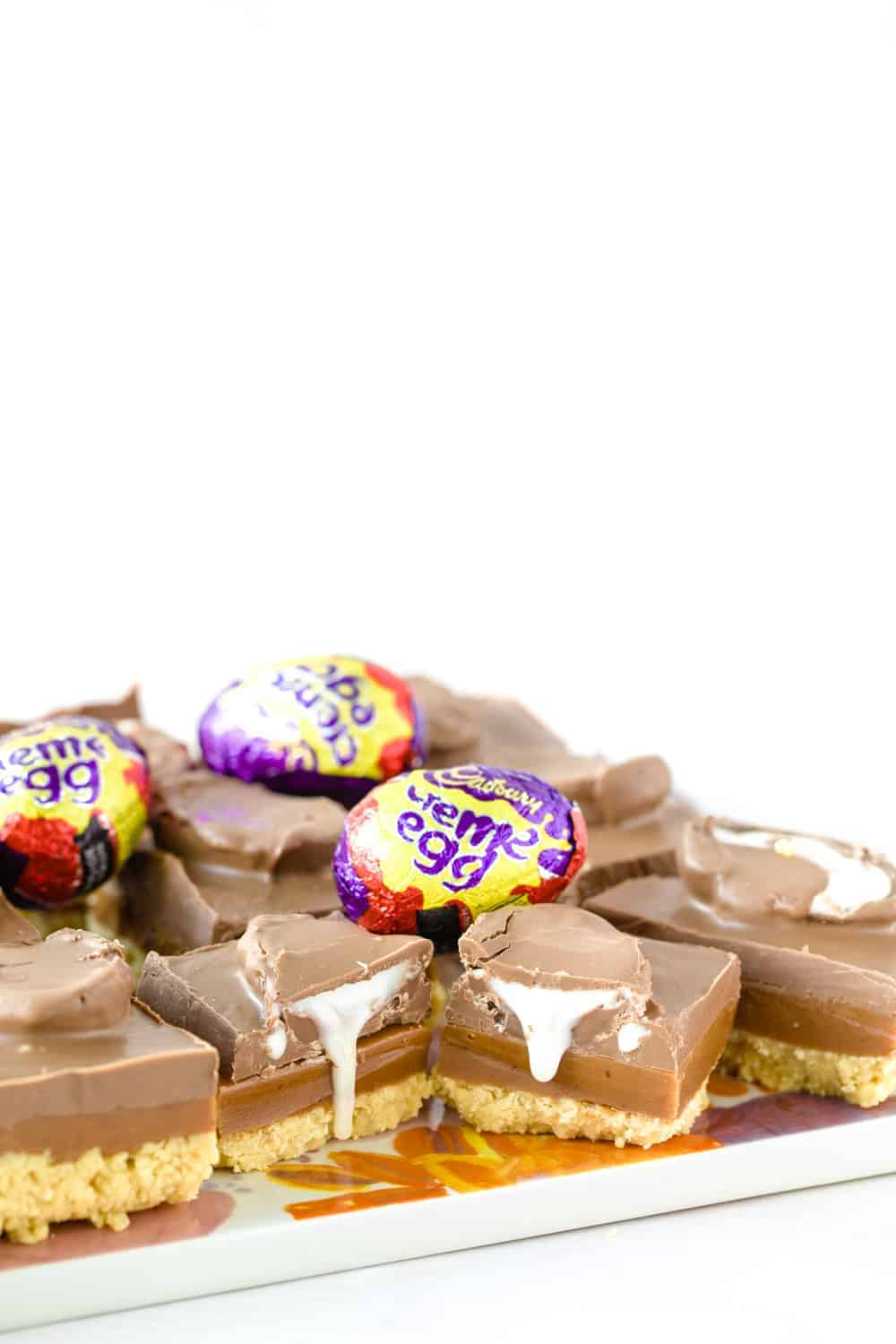 Slices of Creme egg caramel shortbread with Creme eggs on top