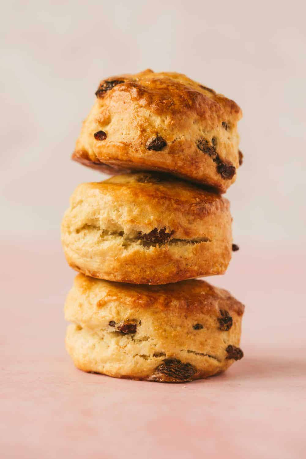 3 sultana fruit scones balanced on top of one another.