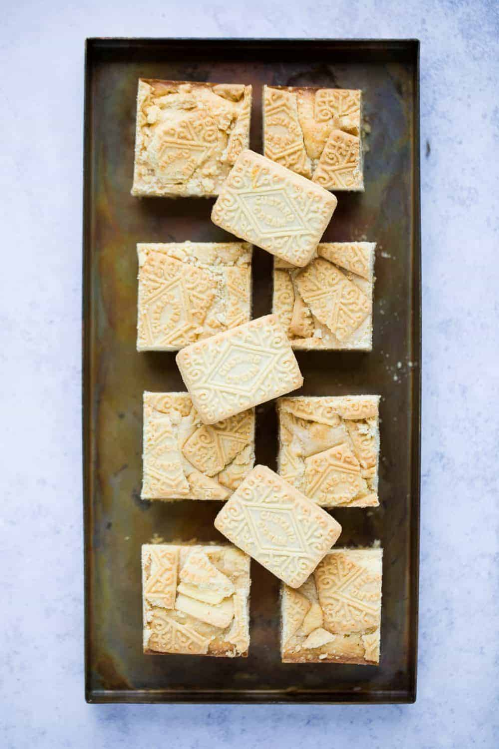 A dark metal tray with square blondies on it.