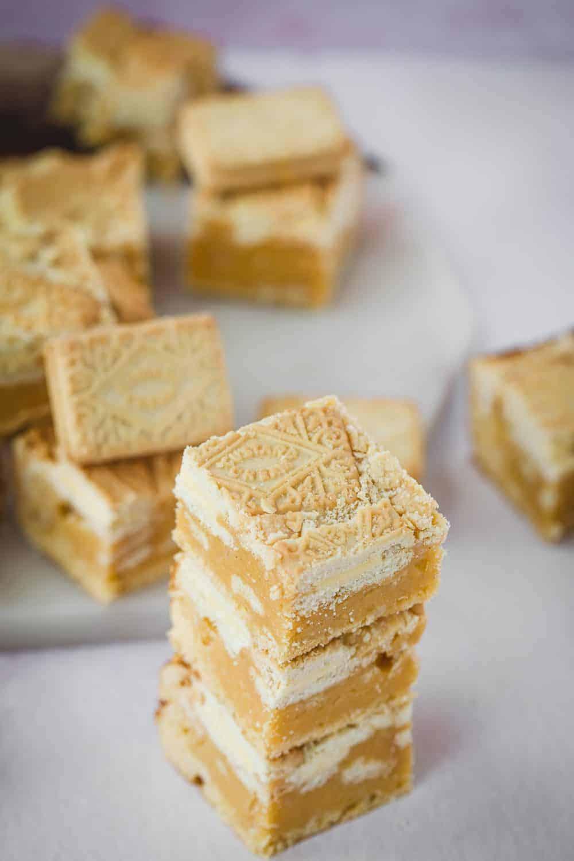 A stack of three custard cream blondies.