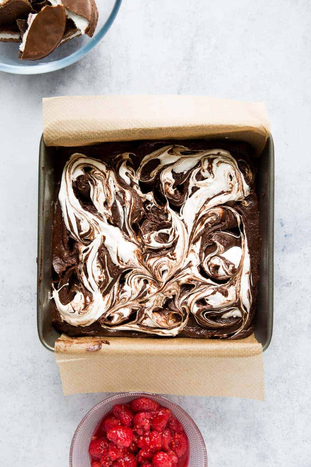 Brownie batter with marshmallow fluff swirled into it.