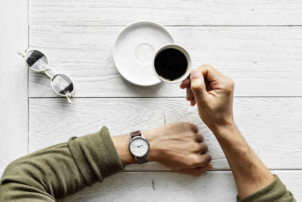Flat lay photography coffee and watch