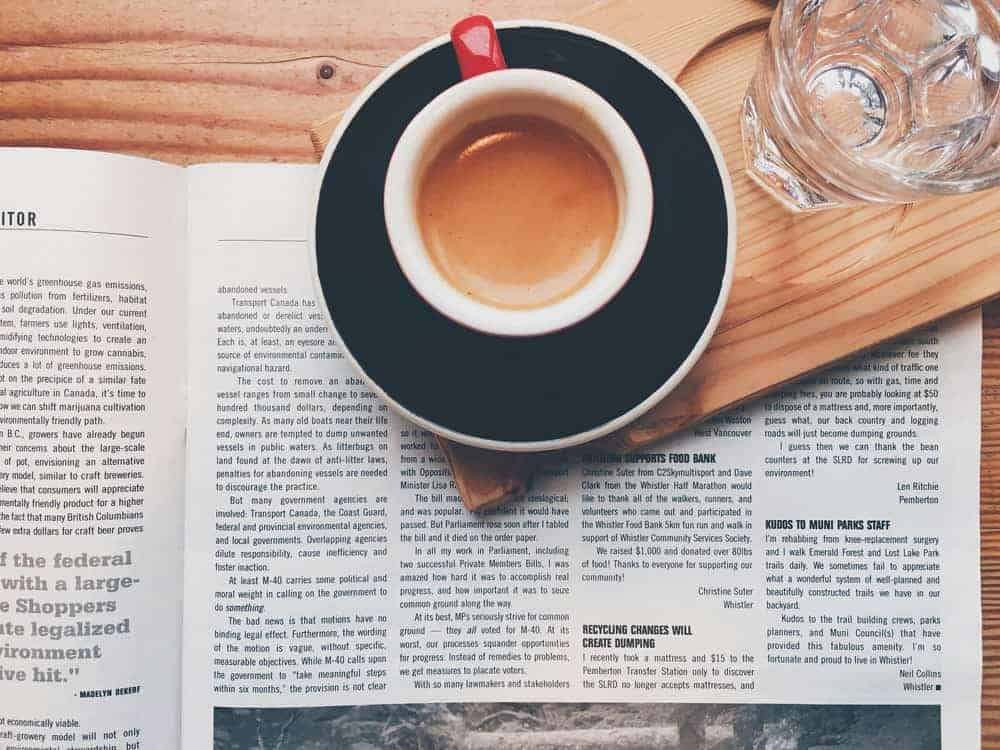 lifestyle photo of coffee and a newspaper