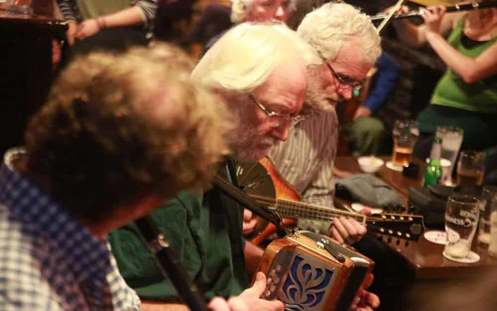 Musicians playing in an Irish Traditional Music session at Cooley's House, Ennistymon, Co. Clare. - The Irish Place