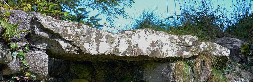 The Ogham Stone used as the lintel in the northern window near the east gable of Seskinan Church - The Irish Place