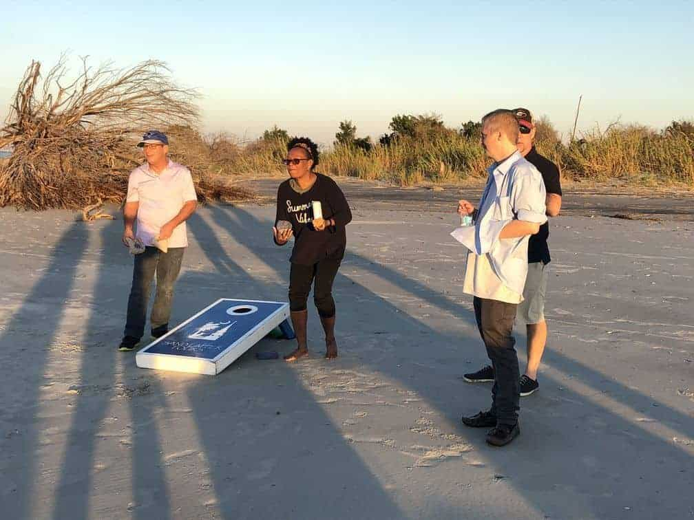 Playing corn hole on the beach. Party boat rental Charleston, SC