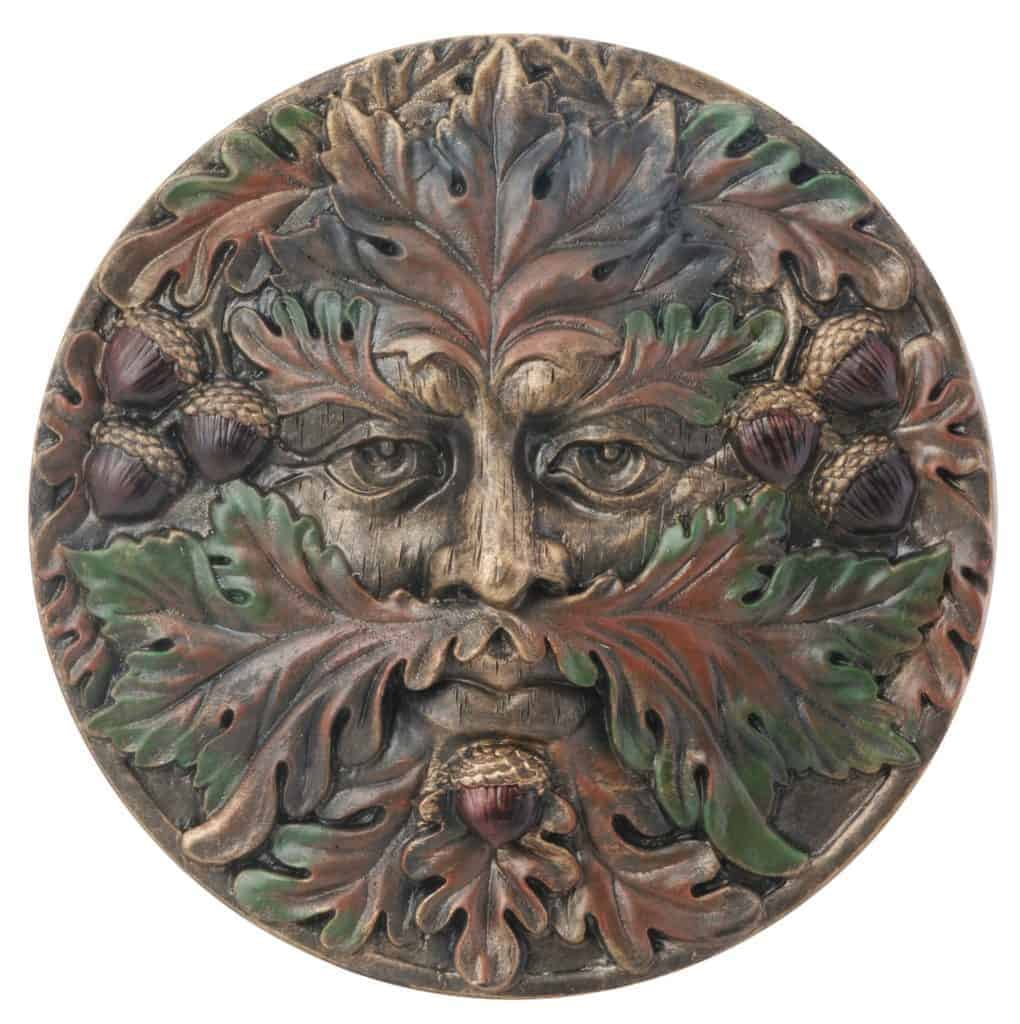 A Green Man face plaque