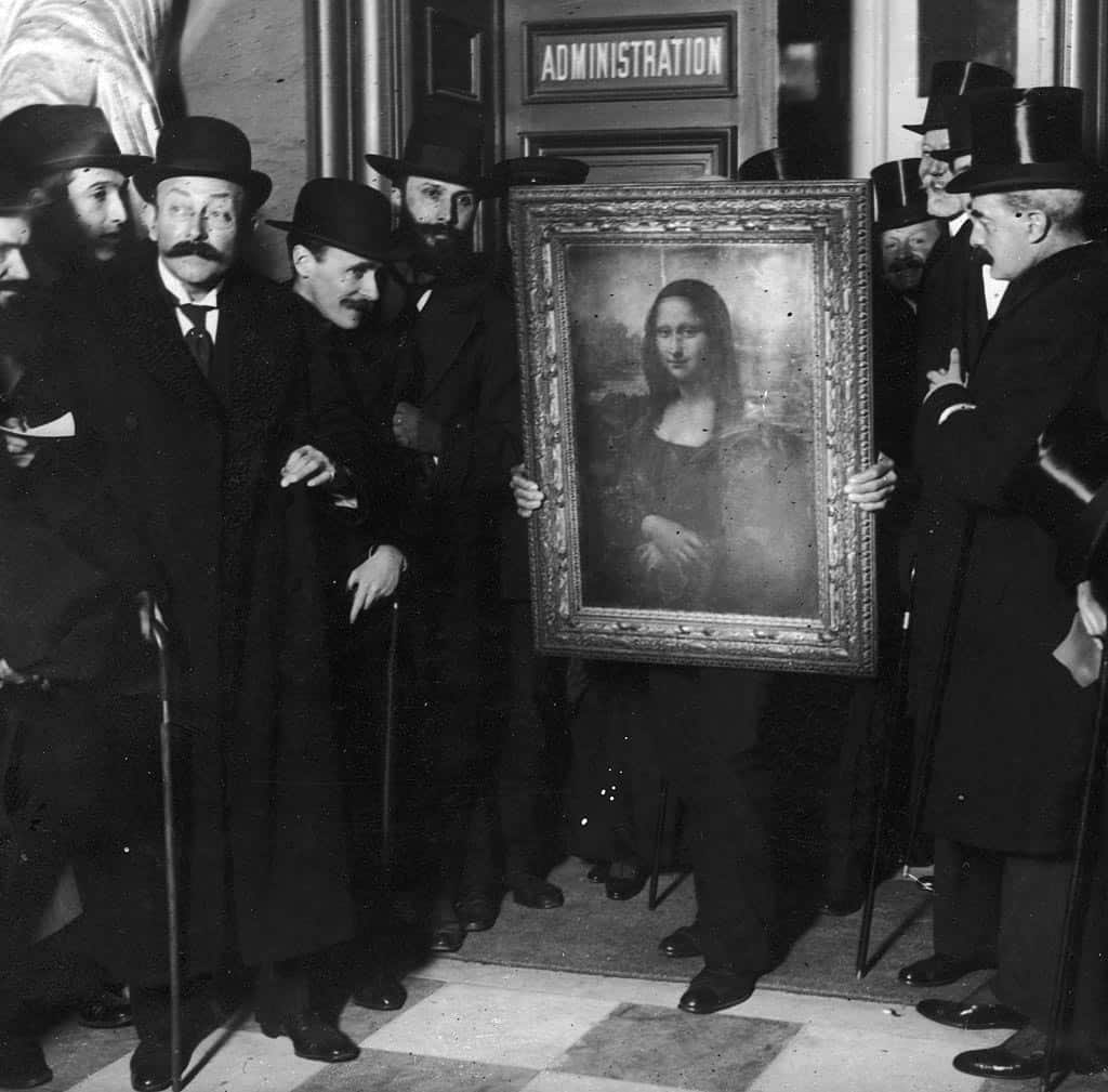 Officials gather around Leonardo da Vinci's 'Mona Lisa' upon its return to Paris, 1914.