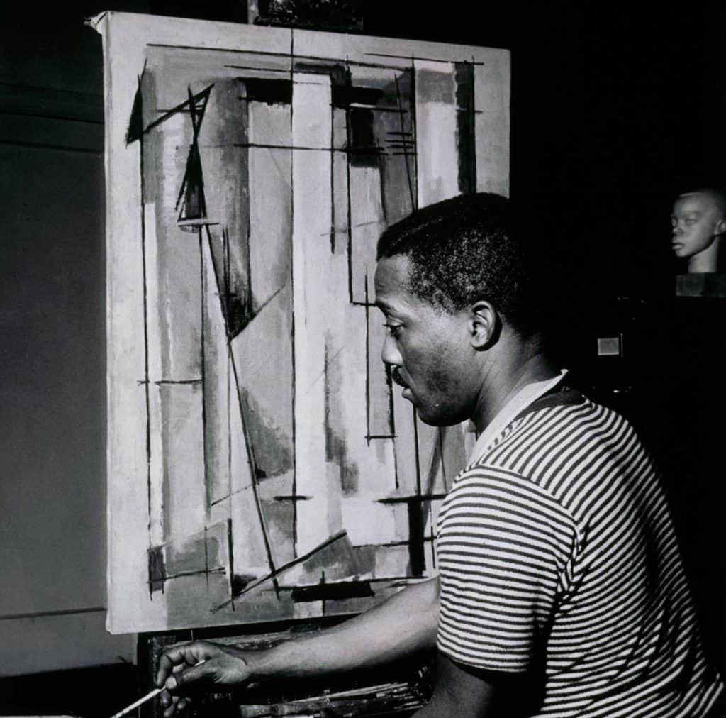 Norman Lewis working on Composition I (1945)