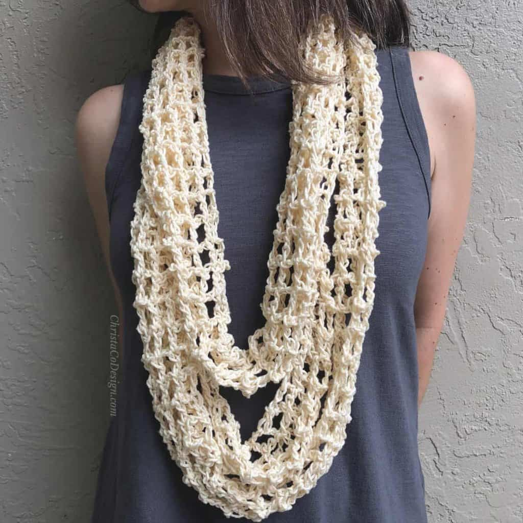 picture of woman wearing cream infinity cowl