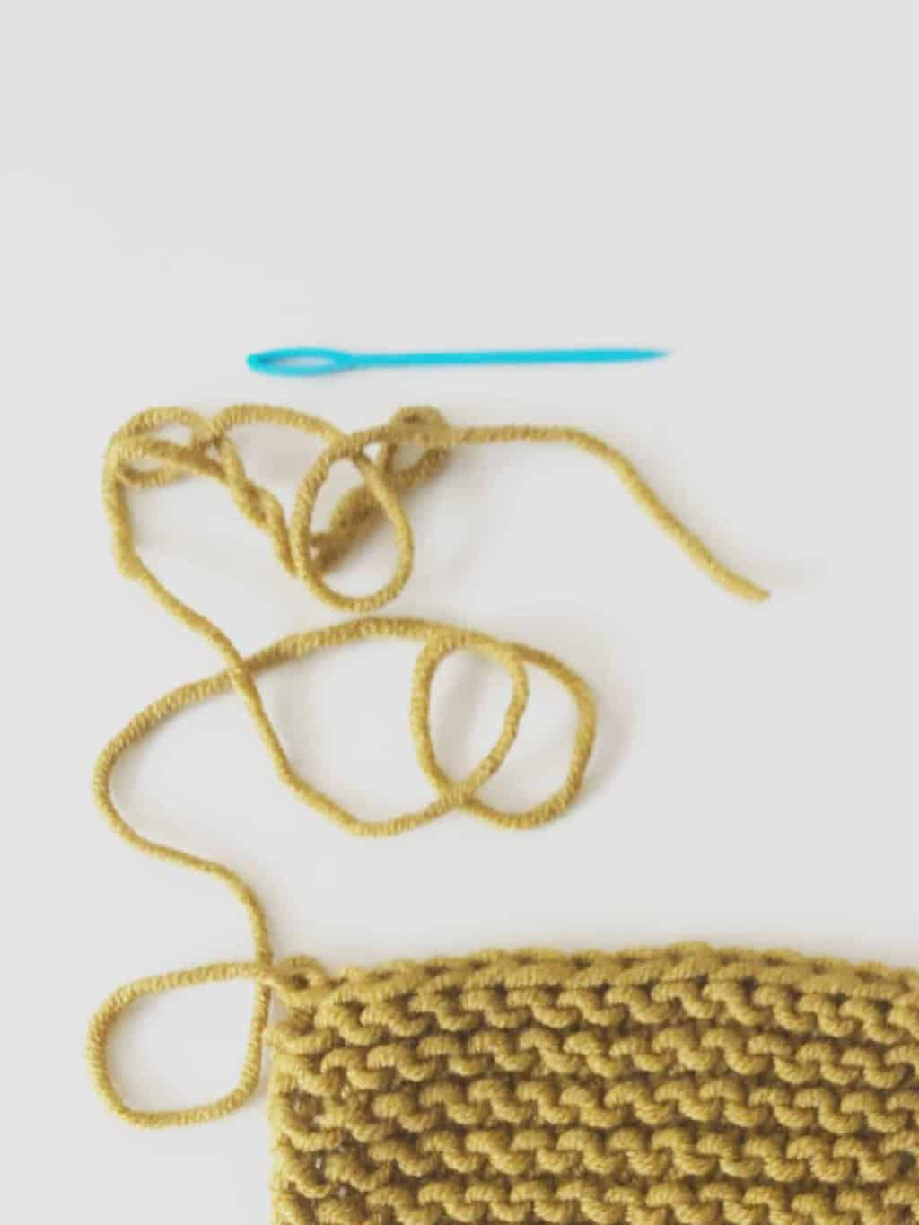 picture of yarn needle and knit pocket