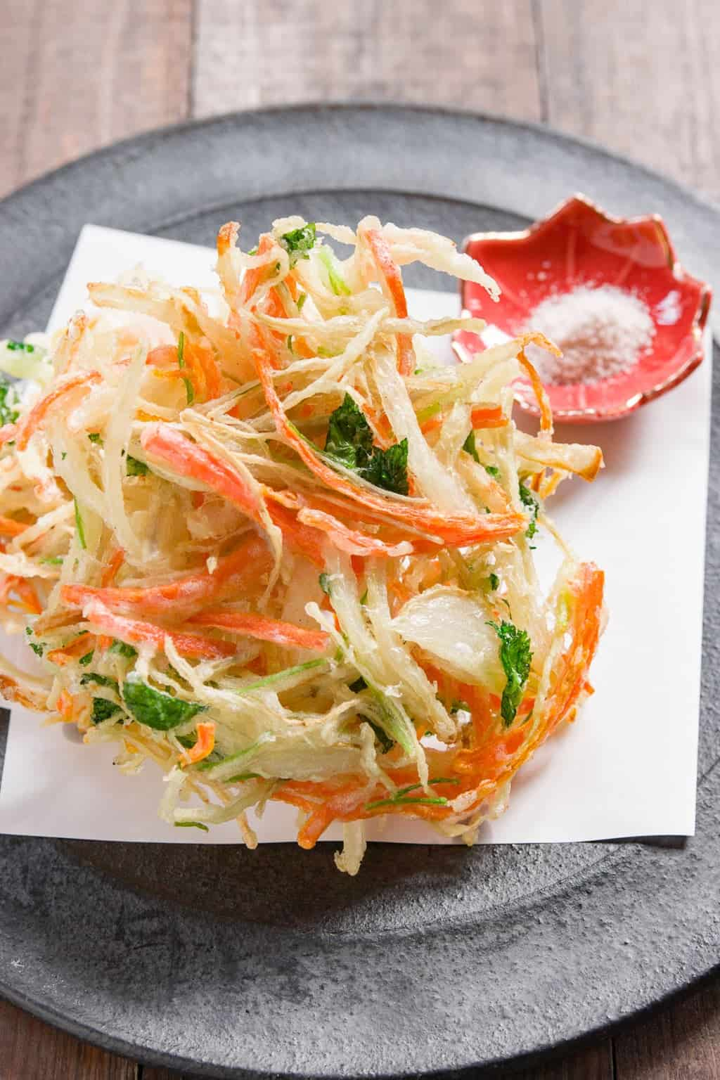 Crispy and delicious, Kakiage are Japanese fritters made with vegetables such as onions and carrots held together with a small amount of tempura batter.