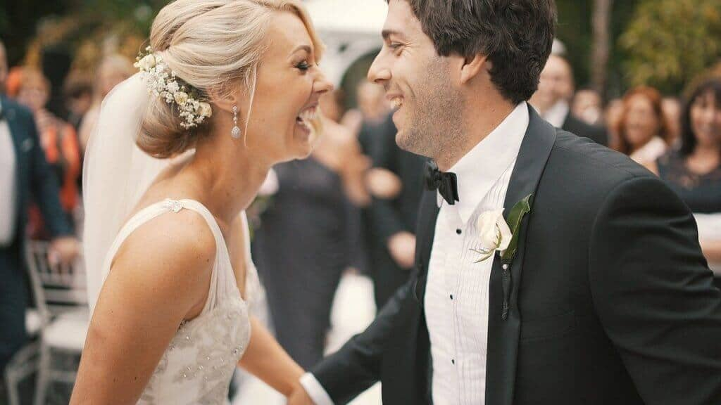 Bride and Groom laughing and looking at each other as we capture the photo from our aerial photography bristol services