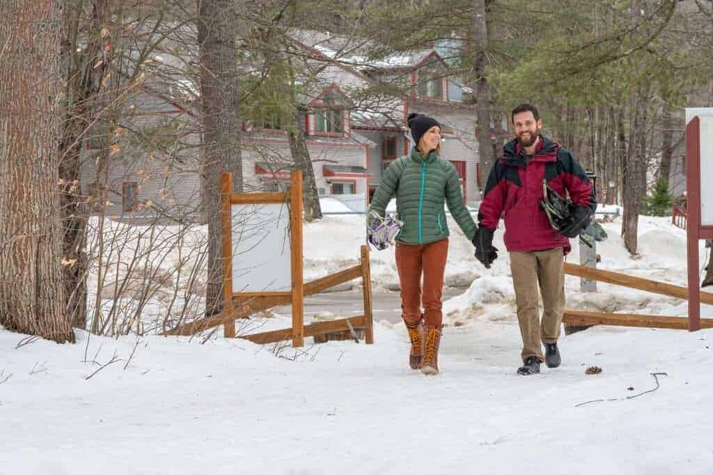 snowshoeing couple on a trail