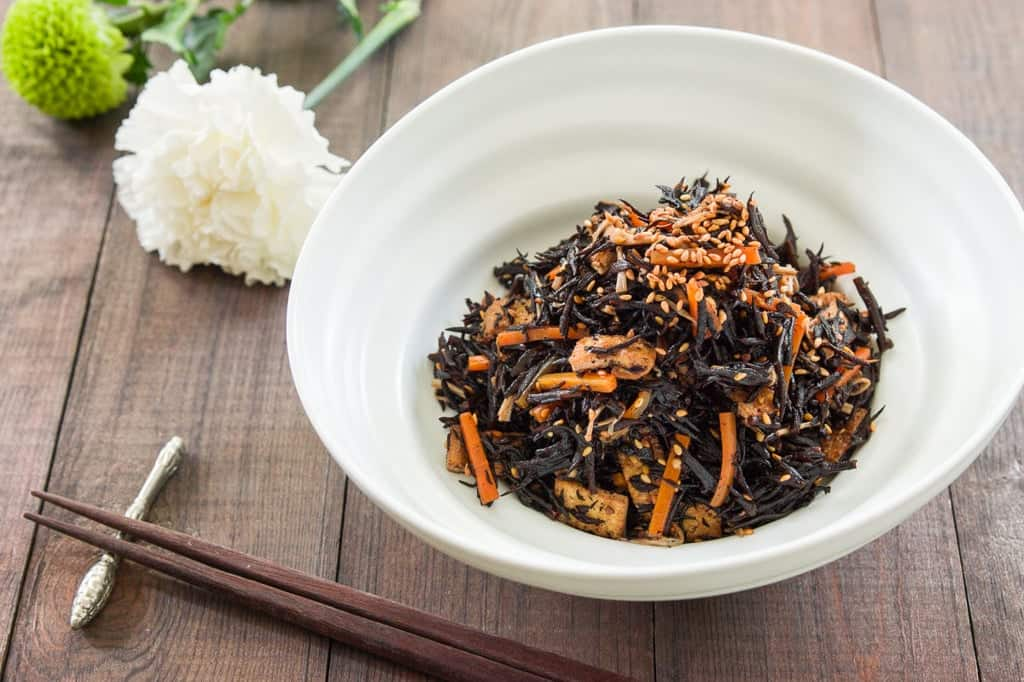 Hijiki no Nimono or Hijiki salad is a Japanese side dish made from seaweed, carrots, fried tofu simmered with soy sauce and sake.