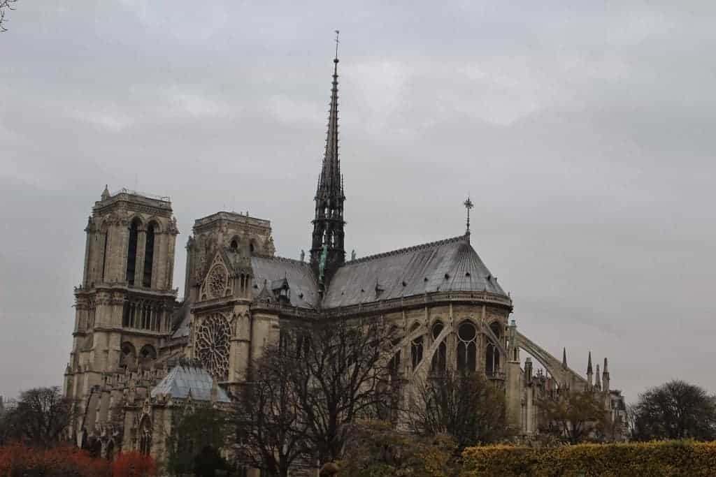 notre dame cathedral Paris from a distance rainy day