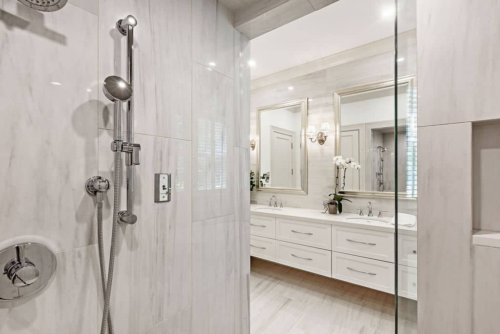 inside of the marble shower, photography of beautiful mirrors inside