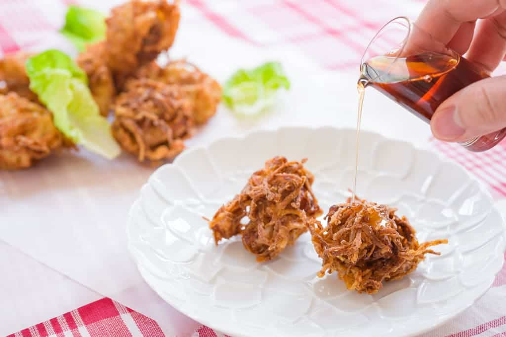 Hash brown coated buttermilk fried chicken goes beautifully with some maple syrup.