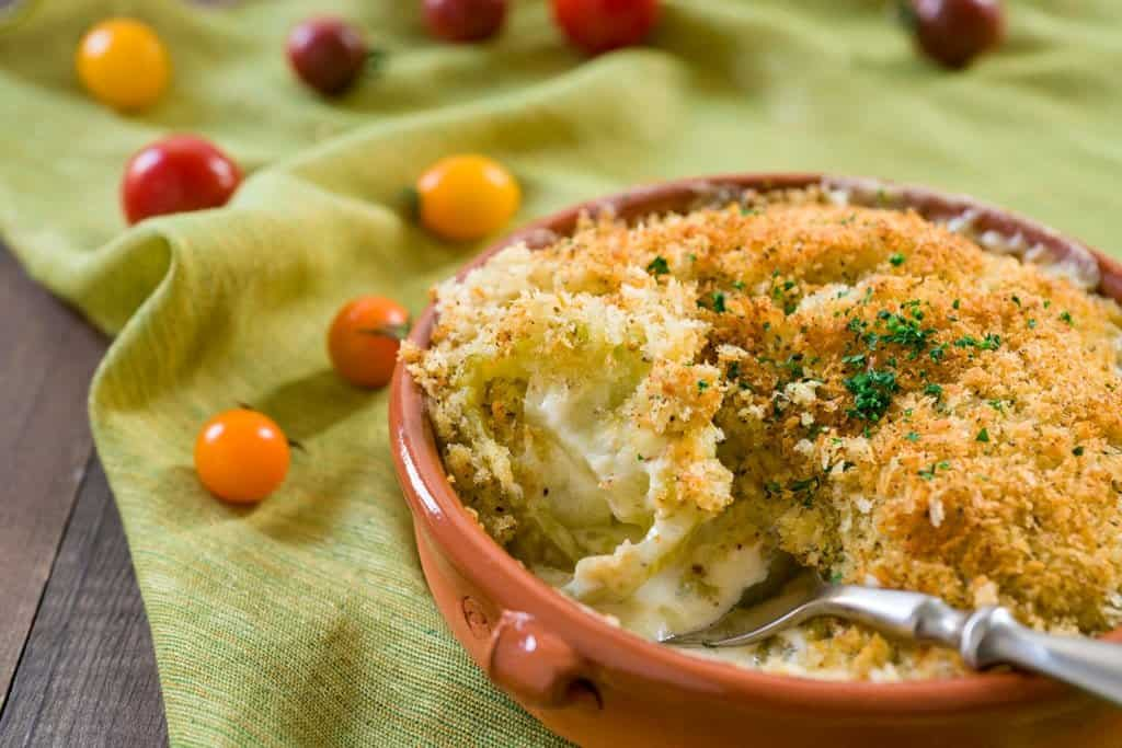 A rich, cheese green tomato gratin with a crispy herb and panko topping.