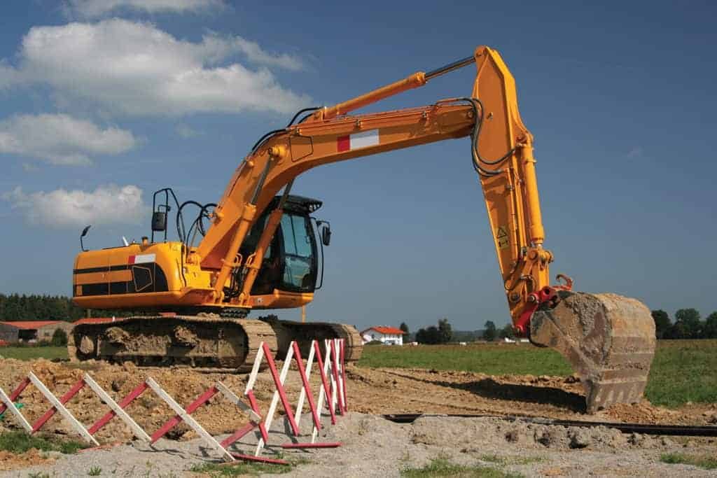 Mechanical Digger in field with safety fence around it