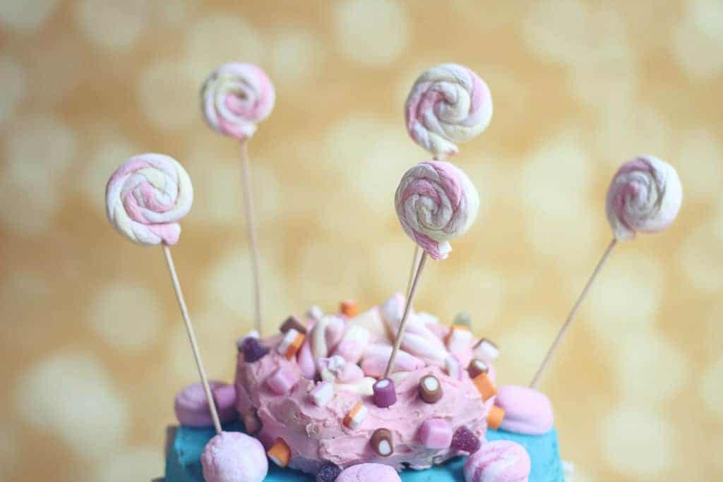Birthday cake with marshmallow swirls on sticks