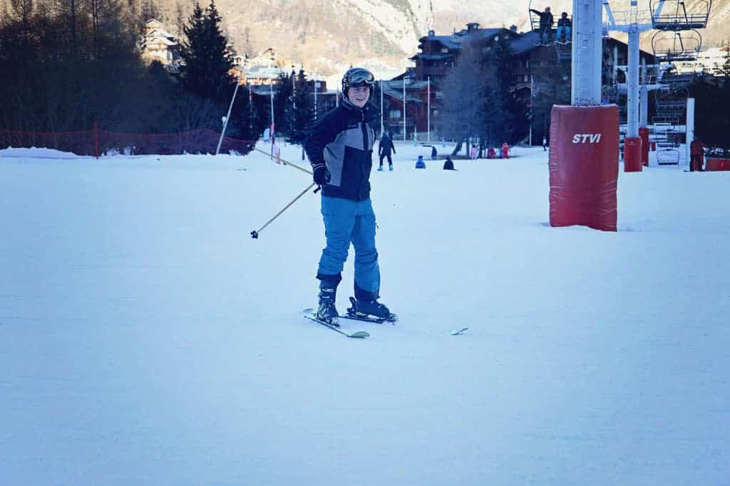 Teenage boy skiing