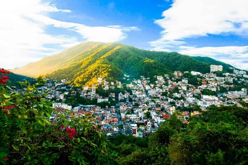 View of the town of Puerto Vallarta with a mountain in the background